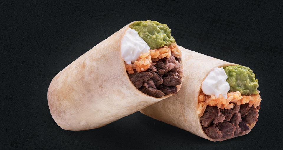 Super Burrito – Rice, bean, and meat burrtio cut in half with salsa
